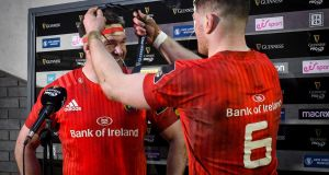 Munster's Billy Holland is presented with the Pro14 man of the match award by Jack O'Donoghue. Photograph: Inpho