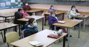 Children wear face masks in class in a Junior School in Jerusalem. Israel reopened schools, almost two months after they were closed due to the coronavirus pandemic. Photograph: Abir Sultan/EPA