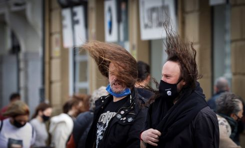 WINDY WEATHER: People struggle against the heavy wind in San Sebastian, Spain, where winds up to 130km/h were registered. Photograph: Javier Etxezarreta /EPA