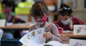 Second-grade pupils attend lessons at the Petri primary school in Dortmund. Photograph: Ina Fassbender/AFP via Getty