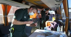 Paramedic Andrew Parker prepares a vaccine inside a holiday coach  near Inverness, Scotland, which is being used  as a mobile coronavirus vaccination centre. Photograph: Andrew Milligan/PA Wire