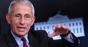 Dr  Anthony Fauci:  said the pandemic arrived in the United States as the country was riven by political divisions in which wearing a mask became a political statement rather than a public health measure. Photograph:  Eric Baradat/Getty Images