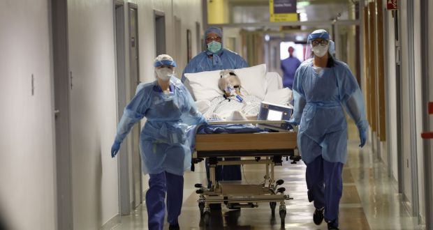 A Covid patient is transferred   along the hospital corridors with medical staff  at St Vincent's hospital in March 2020. One year one, the virus has caused some 4,000 deaths and infected more than 200,000 in the Republic. Photograph: Alan Betson