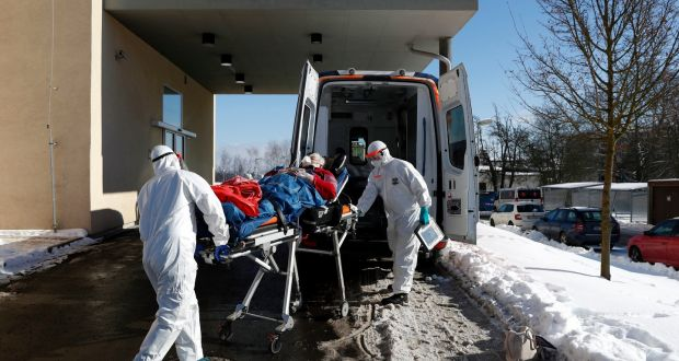 Medical workers move a Covid-19 patient into an ambulance in Cheb, Czech Republic. Photograph: Petr David Josek/File/AP Photo