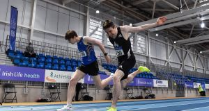 Mark English dips for the line to win the Men's 800m ahead of Cian McPhillips  during day one of the Irish Life Health Elite Athlete Indoor Micro Meet at Sport Ireland National Indoor Arena. Photograph: Sam Barnes/Sportsfile