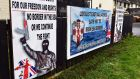 Placards depict a gunman in a Protestant estate in Co Tyrone: the protocol is  an attempt to avoid the worst consequences of Brexit for the island of Ireland, both North and South.