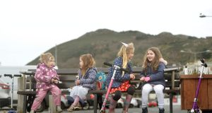 PICNIC: From left; Nora Hoffmann, Catherine Mahoney, Caoilainn Hoffmann and Laila Mahoney all from Bray  enjoy lunch out along the promenade in Bray, Co Wicklow. Photograph: Dara Mac Dónaill/The Irish Times