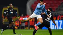 Manchester City's João Cancelo battles with  Borussia Mönchengladbach's Lars Stindl  during the Champions League  round of 16, first-leg match at Puskas Arena in Budapest. Photograph:  PA Wire via DPA