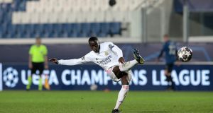 Ferland Mendy of Real Madrid scores their side's late winner from a free-kick  during the Champions League round of 16 first leg against Atalanta  at Gewiss Stadium  in Bergamo. Photograph:  Emilio Andreoli/Getty Images