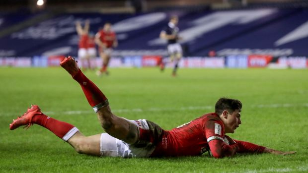 Louis Rees-Zammit dives to score his wonder try against Scotland. Photograph: Tommy Dickson/Inpho