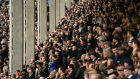 Race goers watch the action at Cheltenham Racecourse on March 10, 2020 in Cheltenham, England. Photograph: Dan Mullan/Getty Images