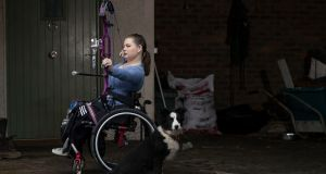 TARGETING TOKYO: Paralympic archer Kerrie Leonard and her dog Freddie pictured at her family farm in Culmullen, Co Meath, as she trains ahead of the Tokyo Olympics. Photograph: Brian Lawless/PA Wire