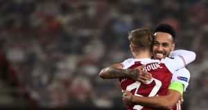 Arsenal's  Emile Smith Rowe and Pierre-Emerick Aubameyang celebrate after their win over Benfica. Photograph: Aris Messinis/Getty/AFP)