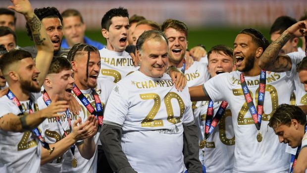 Leeds players and manager celebrate promotion last year. Photo: Michael Regan/Getty Images