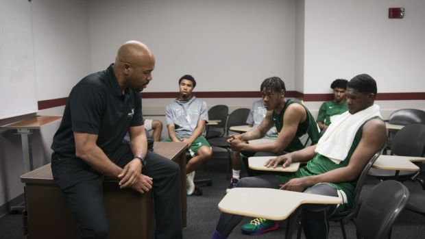 "The East LA College Huskies with John Mosley (Head Coach) in episode 5 ""Colby Ranch"" of Last Chance U: Basketball: Season 1. c. Courtesy of Netflix © 2021"