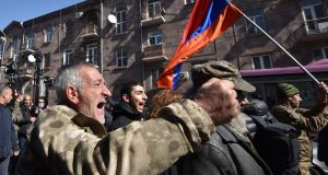 Opposition supporters march through the streets of Yerevan on Friday to demand prime minister Nikol Pashinyan's resignation over his handling of the Nagorno-Karabakh conflict with Azerbaijan. Photograph: Karen Minasyan/AFP via Getty Images
