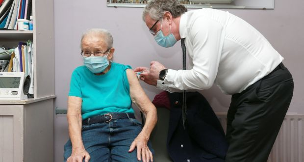 Former Supreme Court judge Catherine McGuinness receives her first Covid-19 vaccination from Dr Rodney Regan. Photograph: Laura Hutton