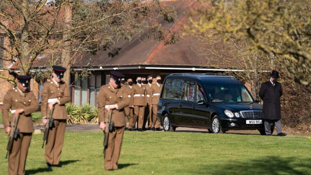 The funeral cortege arrives at the crematorium. Photograph: Joe Giddens/PA Wire