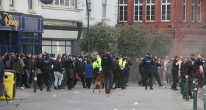Gardaí and protesters outside St Stephen's Green in Dublin on Saturday. Photograph: Ronan McGreevy