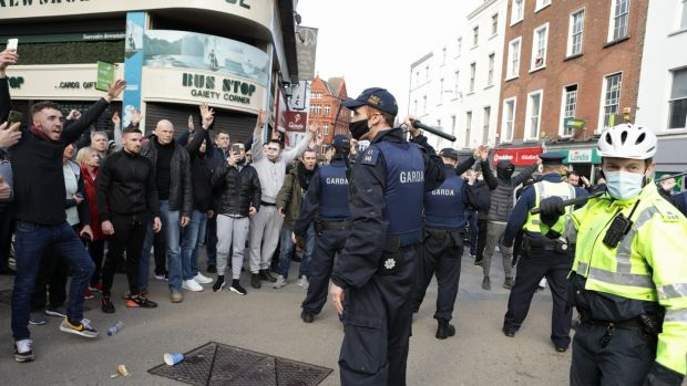 Gardaí address protesters during an anti-lockdown demonstration in Dublin city centre. Photograph: Damian Eagers/PA Wire