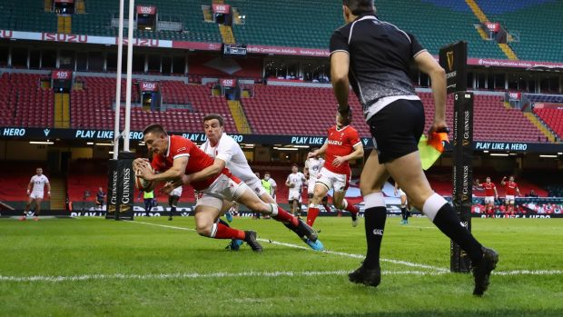 Josh Adams scores the opening try for Wales against England. Photograph: Michael Steele/Getty