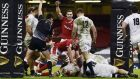 George North celebrates as Cory Hill scores Wales's bonus point try against England. Photograph: Rebecca Naden/EPA