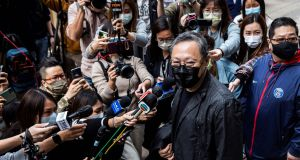 Hong Kong law professor and pro-democracy activist Benny Tai  outside Ma On Shan police station on Sunday. Photograph:  Isaac Lawrence/AFP via Getty Images