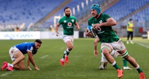 Will Connors strolls over for his first of two tries against Italy. Photograph: Tommy Dickson/Inpho