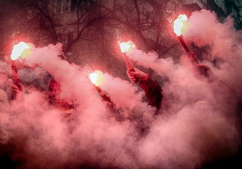 Activists light flares at a rally in front of Ukraine's prosecutor general's office protesting against corruption inside the country's court system and demanding reforms in Kiev, Ukraine. Photograph: Efrem Lukatsky/AP Photo