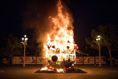 A carnival float shaped like the Covid-19 virus is burned as an homage to the Nice carnival which was cancelled this year in Nice, southern France. Nice and the surrounding coastal area will be under weekend lockdowns for at least two weeks, in addition to a national 6pm to 6am curfew, imposed to curb soaring Covid-19 infections. Photograph: Daniel Cole/AP Photo
