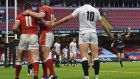 Josh Adams and Jonathan Davies celebrate a try as England outhalf George Ford appeals to referee Pascal Gauzere. Photograph: Getty Images