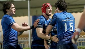 Leinster's Jimmy O'Brien and Josh van der Flier celebrate with Luke McGrath after he scores a try. Photograph: Inpho