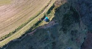 A family set up a tent on the top of a 280ft cliff. Photograph: HM Coastguard/Twitter