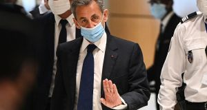 Former president Nicolas Sarkozy arriving at the Paris courthouse on Monday. Photograph: Anne-Christine Poujoulat/AFP via Getty Images