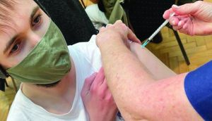Covid jab: a passing doctor kindly photographed me being vaccinated in central London