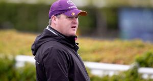 The British Horseracing Authority has banned Gordon Elliott from running horses in Britain pending the outcome of an investiagtion into a  photograph showing him sitting on a dead horse on his gallops. Photograph: Morgan Treacy/Inpho