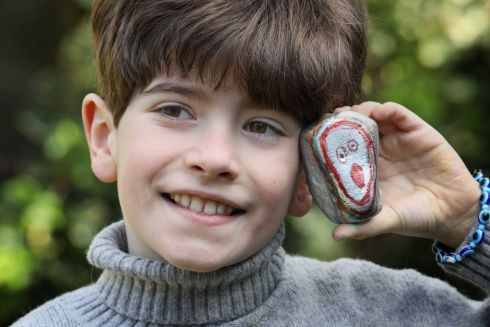 CREATIVE ENTHUSIASM: Teddy Duggan (8), from Terenure, Dublin, with one of his painted stones, which won the 8-11 year-old category of the RTÉ Creative Ireland This Is Art! initiative. Almost 9,000 young people responded with creativity and enthusiasm to the initiative. See rte.ie/thisisart . Photograph: Mark Stedman