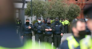 Gardaí pictured on Grafton Street, Dublin during an anti-lockdown protest on Saturday. Photograph: Dara Mac Dónaill/ The Irish Times