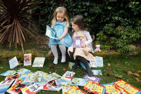 WORLD BOOK DAY: Sisters Milly (3) and Lia (6) Rea share a story to celebrate World Book Day on March 4th. World Book Day takes the transformative power of reading with a fun-packed day of free digital events, videos and online activities. See worldbookday.com/Ireland for more information: Photograph: Leon Farrell/Photocall Ireland