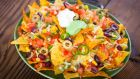 Nachos with all the toppings. Photograph: iStock.