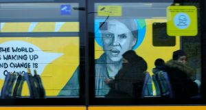 A Luas passes the Greta Thunberg mural, by Emma Blake, which was cleaned after it was vandalised within 24 hours of being completed. Photograph: Gareth Chaney/Collins Photos Dublin