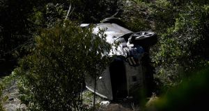 Tiger Woods'  SUV    on its side in Rancho Palos Verdes, California, on February 23th. Photograph: Getty Images