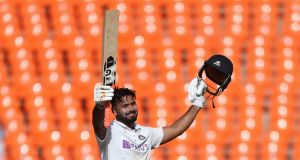 India's Rishabh Pant celebrates scoring his fine century on Friday. Photograph: Aijaz Rahi/AP