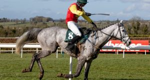 Hugh Morgan on Young Dev won at Navan despite braking  a stirrup at the first fence. Photograph: Morgan Treacy/Inpho