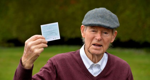 Retired sports commentator Mícheál Ó Muircheartaigh with his HSE vaccine card: he received his first injection at the Blanchardstown Primary Care Centre on Thursday. Photograph: Alan Betson