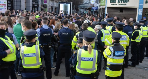 Gardaí in Dublin during an anti-lockdown  protest last Saturday. National Garda resources have been made available for the protest in Cork in addition to local and divisional gardaí. Photograph: Dara Mac Dónaill