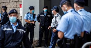 Police officers stand guard outside the High Court in Hong Kong. Photograph: Isaac Lawrence/AFP/ Getty Images