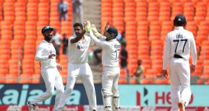Ravichandran Ashwin celebrates with Cheteshwar Pujara and Rishabh Pant after taking the wicket of Zak Crawley of England during day three of the fourth Test at the Narendra Modi Stadium in Ahmedabad, India. Photo: Surjeet Yadav/Getty Images