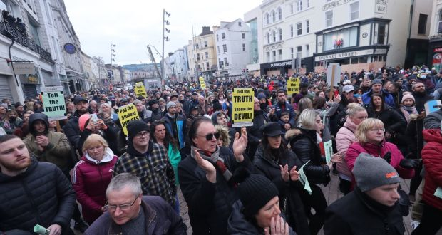 People take part in a demonstration against lockdown restrictions organised by the People's Convention in Cork city centre. Photograph: Niall Carson/PA Wire