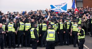 Rangers fans and police presence outside the ground ahead the Scottish Premiership match at Ibrox Stadium, Glasgow. Photo: Robert Perry/PA Wire